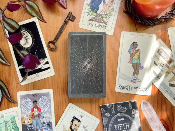 Cards from the Fifth Spirit Tarot laid out on a table