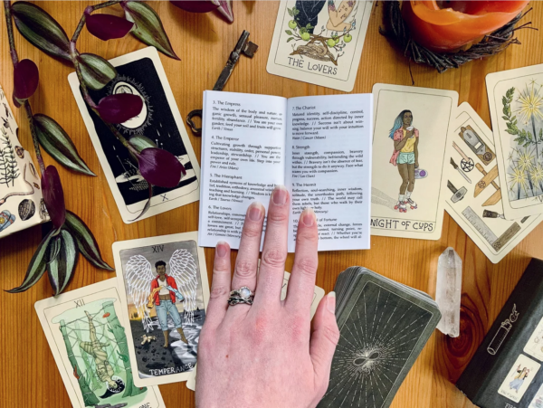 Cards and booklet for the Fifth Spirit Tarot, laid out on a table